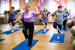 Fitness training for elderly and disabled Stock Images