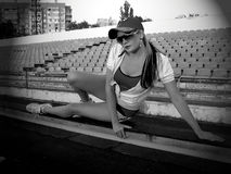 Fitness, training, the girl has a rest after evening jog Royalty Free Stock Images