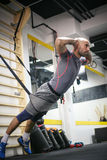 Fitness training in the gym. Royalty Free Stock Image