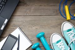 Fitness training and healthy lifestyle blog background with notebook and dumbbells Royalty Free Stock Photo