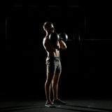 Fitness training. Man doing exercises with weights Royalty Free Stock Photo