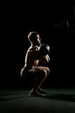 Fitness training. Man doing sit ups with weights Stock Image