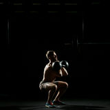 Fitness training. Man doing sit ups with weights Stock Photography