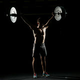 Fitness training. Man standing with barbell Stock Photos