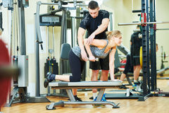 Fitness training. Personal trainer works with woman Stock Image