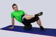 Fitness training with pilates roll Stock Image