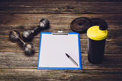 Fitness training plan or diet. Blank paper page royalty free stock photography