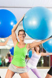 Fitness - Training and workout in gym Stock Image