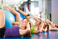 Fitness - Training and workout in gym Stock Images