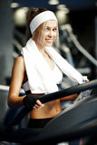 Fitness on a treadmill Stock Photos