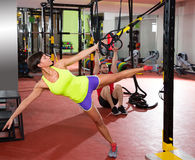 Fitness TRX training exercises at gym woman and man. Crossfit fitness TRX training exercises at gym women and dip rings men workout Stock Photos