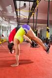Fitness TRX training exercises at gym woman and man Stock Image