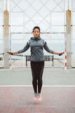 Fitness urban woman jumping rope Royalty Free Stock Images