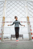 Fitness urban woman jumping rope Royalty Free Stock Photos