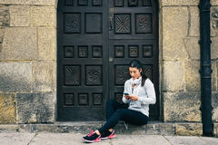 Fitness urban woman rest for texting on smartphone Stock Photo