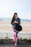 Fitness urban woman with smartphone Royalty Free Stock Photography