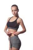 Fitness vrouw in sportstijl die zich tegen witte achtergrond bevinden royalty-vrije stock afbeeldingen