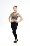 Fitness vrouw in sportstijl status geïsoleerd op witte achtergrond Stock Fotografie