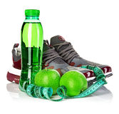 Fitness, weight loss concept with green apples, bottle of drinking water and tape measure Royalty Free Stock Photo
