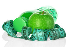Fitness, weight loss concept with green apples, bottle of drinking water and tape measure Royalty Free Stock Images