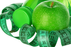 Fitness, weight loss concept with green apples, bottle of drinking water and tape measure Stock Photography