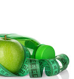 Fitness, weight loss concept with green apples, bottle of drinking water and tape measure Royalty Free Stock Image
