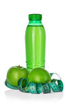 Fitness, weight loss concept with green apples, bottle of drinking water and tape measure isolated on white Stock Photo