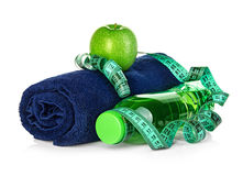 Fitness, weight loss concept with sneakers, green apples, bottle of drinking water and tape measure Royalty Free Stock Photography