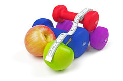 Fitness weights apples and measuring tape Royalty Free Stock Photo