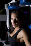 Fitness Woman. A pretty young Caucasian woman using fitness equipment Royalty Free Stock Image