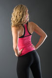 Fitness woman. Young woman poses wearing her fitness outfit Stock Photography