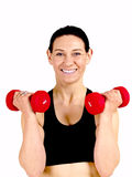 Fitness woman. Middle aged woman with weights staying in shape Stock Photo