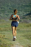 Fitness woman. A tall caucasian fitness woman running in a marathon competition in nature during summer in South Africa Stock Photo