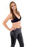 Fitness Woman. Happy pretty woman with fitness clothes on white background Stock Image
