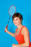 A fitness woman. A happy woman with a badminton racket Stock Photography
