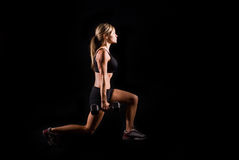 Fitness woman. A young woman working out on a plain backdrop Royalty Free Stock Image