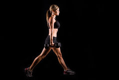 Fitness woman. A young woman working out on a plain backdrop Royalty Free Stock Photo