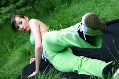 Fitness Woman. Fitness young woman on the ground stock photography