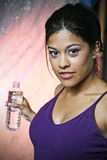 Fitness woman. Beautiful woman in fitness attire holding a water bottle Royalty Free Stock Photography