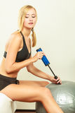 Fitness woman with air pump inflating fit ball Royalty Free Stock Photography