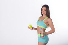 Fitness woman with apple and bottle of water Royalty Free Stock Image