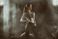 Free Fitness Woman, Asian Athletic Woman Pumping Up Muscles With Dumbbells. Stock Image - 82168361