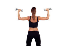 Fitness woman back lifting dumbbells Stock Image