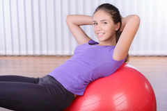 Fitness. Woman on a fitness ball in a gym Royalty Free Stock Photography