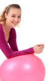 Fitness woman  with ball smiling joyful and happy, isolated on w Royalty Free Stock Photos