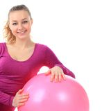 Fitness woman  with ball smiling joyful and happy, isolated on w Stock Image