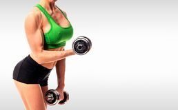 Fitness woman with barbells Stock Images