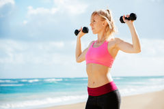 Fitness woman with barbells working out Royalty Free Stock Photography