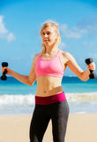 Fitness woman with barbells working out Royalty Free Stock Image
