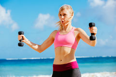 Fitness woman with barbells working out Royalty Free Stock Photos